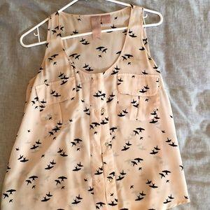 Silk sleeveless blouse with bird print